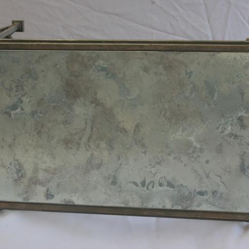 metal table, antique mirror top