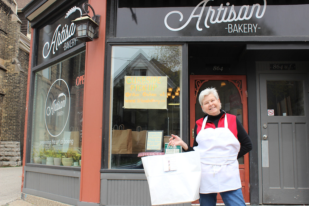 Greeted with a very warm hello from Paulette for curb side pickup at Artisan Bakery!