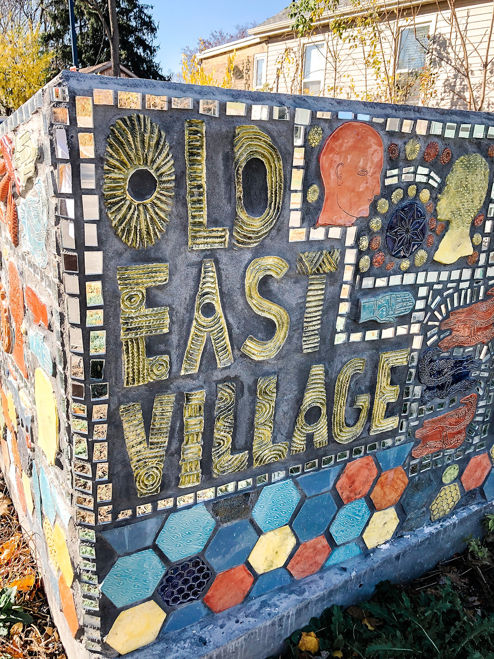 A mural made of ceramic pieces that reads: Old East Village
