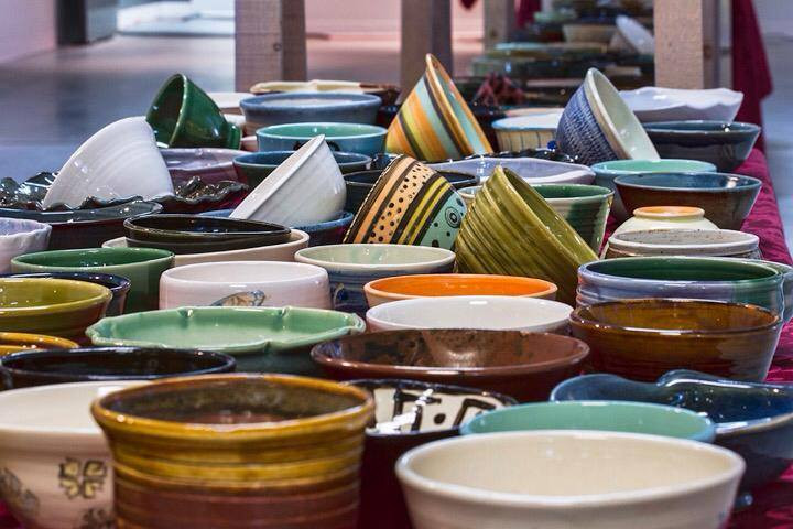 A beautiful selection of one-of-a-kind bowls at 2018's event. Photo via londonclayartcentre.org/empty-bowls