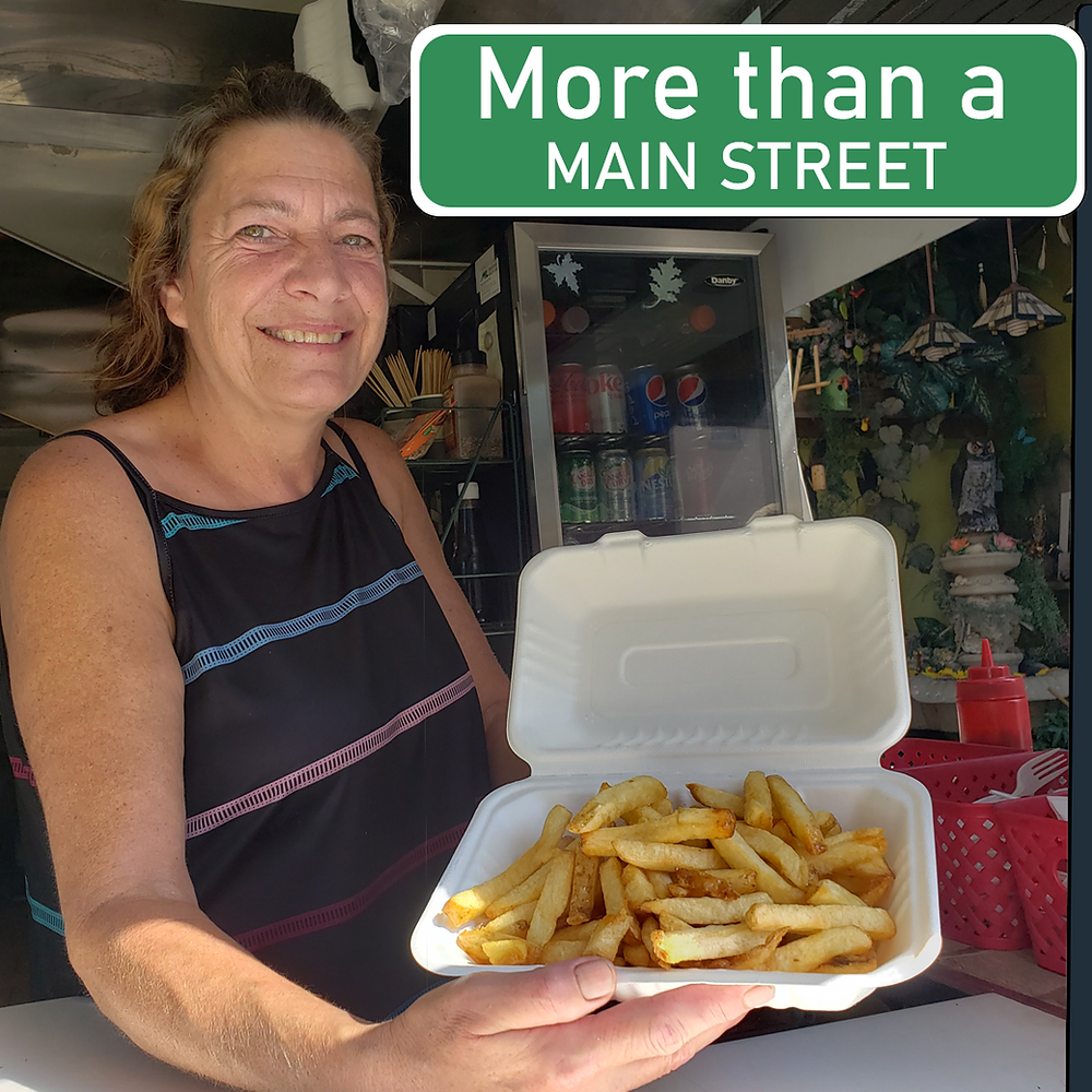 Roxanna Talbot, the owner of Maymo's Fry holds an open container of French Fries