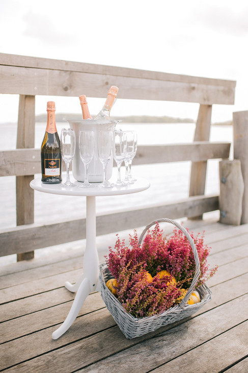 A wedding set up with flowers and champagne, one of the many details that go into setting up our wedding packages abroad for two in Denmark.