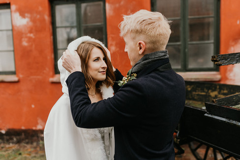 A romantic moment during husband and wife as they embrace each other during their Scandinavian wedding adventure at Mon Island,