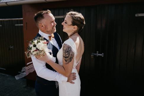 Newlyweds hugging during their Scandinavian wedding in Denmark.