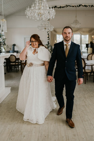 the-bride-and-the-groom-holds-each-other-in-hand