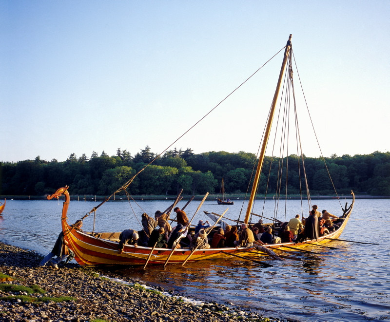 The group of people  onboard of the viking ship