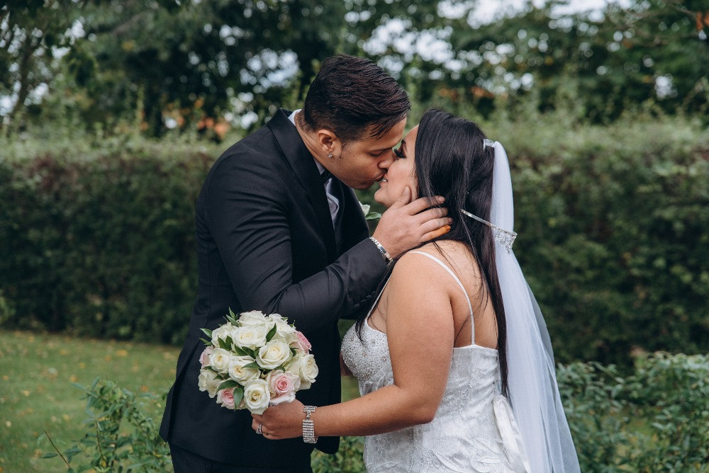 A groom kissing his bride while they getting married on Danish island of Lolland