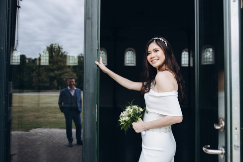 A happy bride looking at groom during their elopement wedding in Denmark