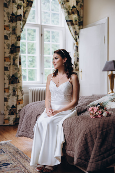 A bride in her room preparing for her Danish wedding at the Vindeholme Castle.