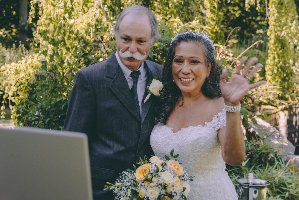 Senior couple streaming their wedding to the families coz they eloped abroad