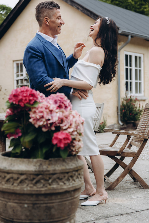 Newlyweds looking romantically into each other's eyes and smiling during their wedding abroad in Denmark.