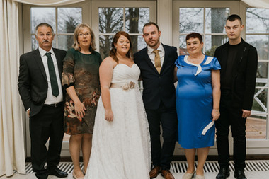 A family photo during an adventure wedding in Denmark, one of the best places to elope for small weddings abroad.