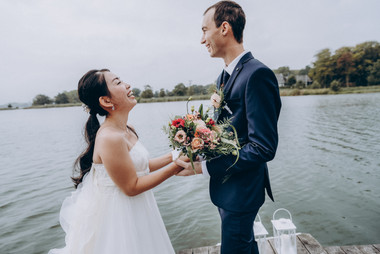 Laughed and happiness by the newlyweds as they elope abroad to Denmark to get married by the Maribo Lake, a great marry abroad idea for adventurous couples.