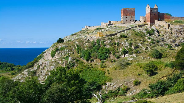 Get married abroad at Hammershus Ruins pictured here. Found on Bornholm Island, this Medieval Fortress with a sea-view will turn your island wedding into an adventure wedding.
