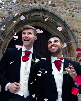 Two grooms during their gay marred in Denmark in front of their castle wedding venue.