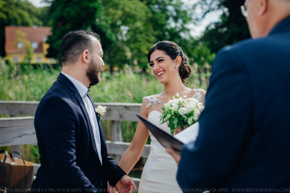 A foreign couple getting married in Denmark by Maribo lakes