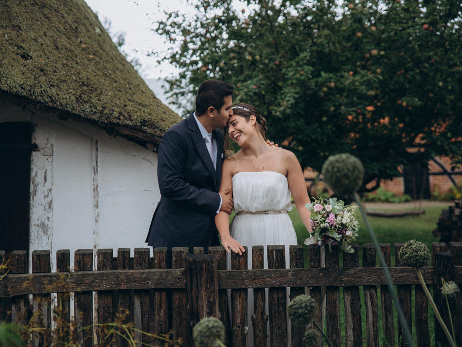 Getting married in Denmark in an open-air museum is exactly what couple did for their Nordic country-style wedding abroad.