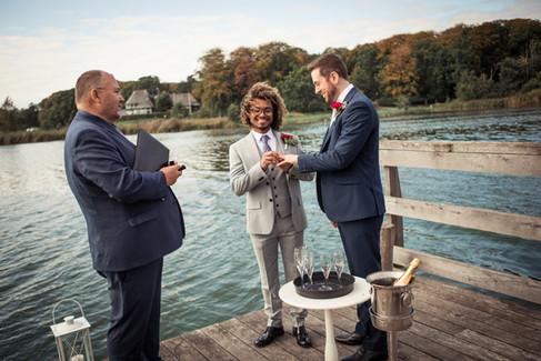 A LGBT wedding ceremony by the Maribo Lake, an intimate and romantic Denmark wedding venue for gay couples.