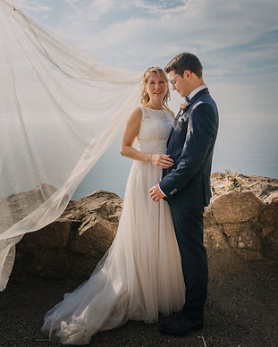 A couple eloping to Bornholm Island as a part of their all-inclusive Denmark wedding package adventure.
