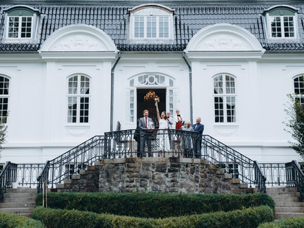 A family celebrating an overseas wedding at the Vindeholme castle venue.