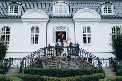 A family celebrating a small wedding abroad at the Vindeholme Castle, a top destination and wedding venue for romantic adventure elopements.