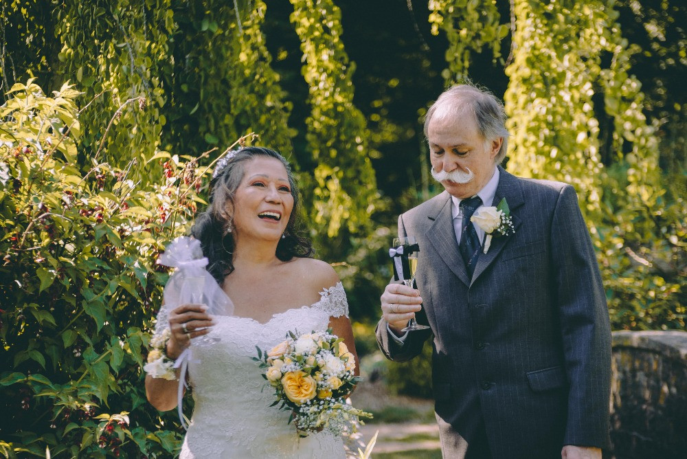 Newlyweds seniors toasting in the garden where they marry each other