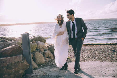 Newlyweds walking around the beach as they get married in Denmark