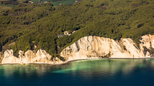 A view of Møns Klint, the chalk cliffs that stretch across Møn Island, a perfect marry abroad idea for couples that want to elope to Denmark and get married abroad.