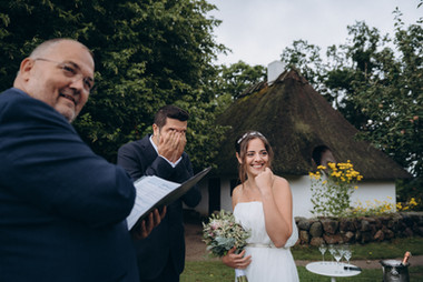 An emotional moment during a green wedding in Denmark in an open-air museum, an ideal wedding venue for couples that want a small wedding abroad.