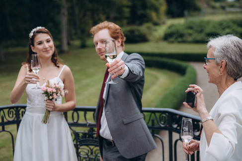 A groom toasting during his castle wedding, a great idea for couples looking for getting married in Denmark
