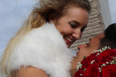 An intimate moment where a bride gazes into her husband's eyes as she smiles while getting married in Denmark.