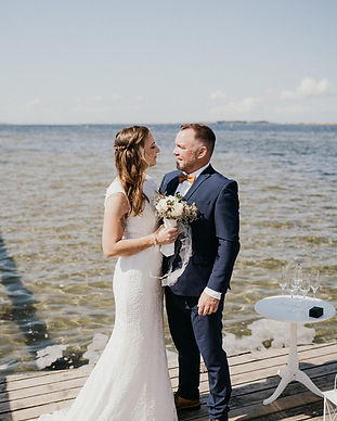 A couple looking into each other's eyes as they have fun on their Scandinavian wedding in Denmark.