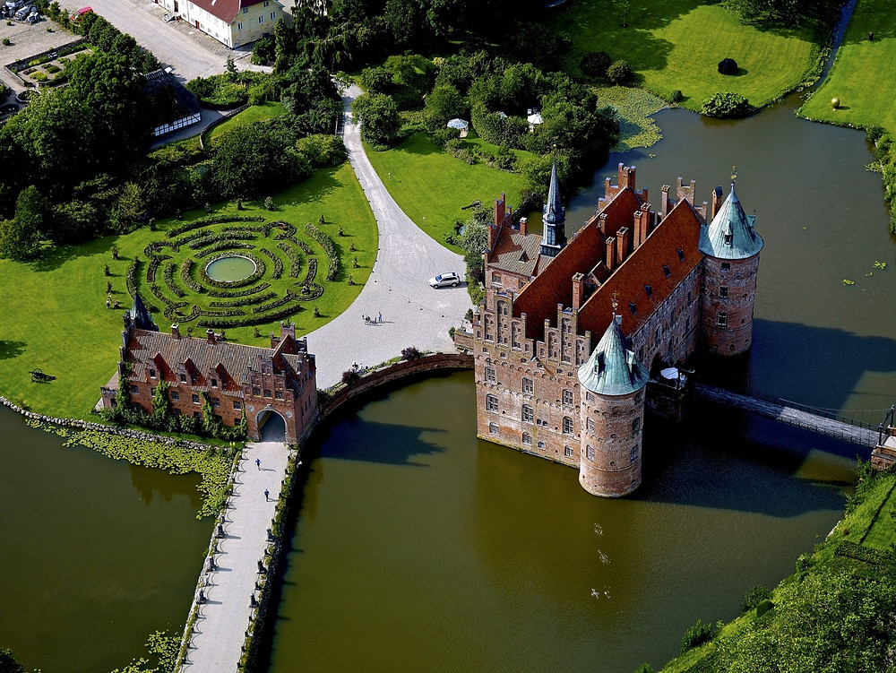 The photo of Egeskov castle -the perfect destination to your adventure wedding in Denmark