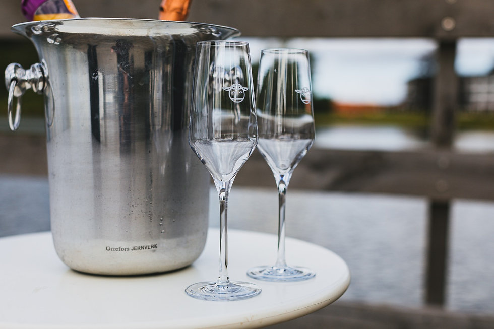 Two champagne glasses, toast your adventure wedding or elopement abroad today.