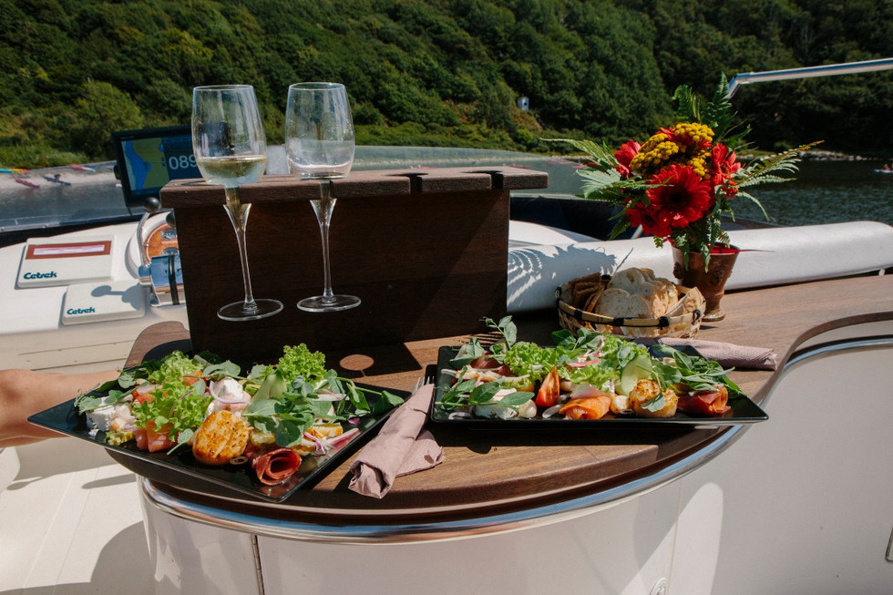 A setup with the glasses and tapas for celebrating small yacht wedding abroad in Denmark