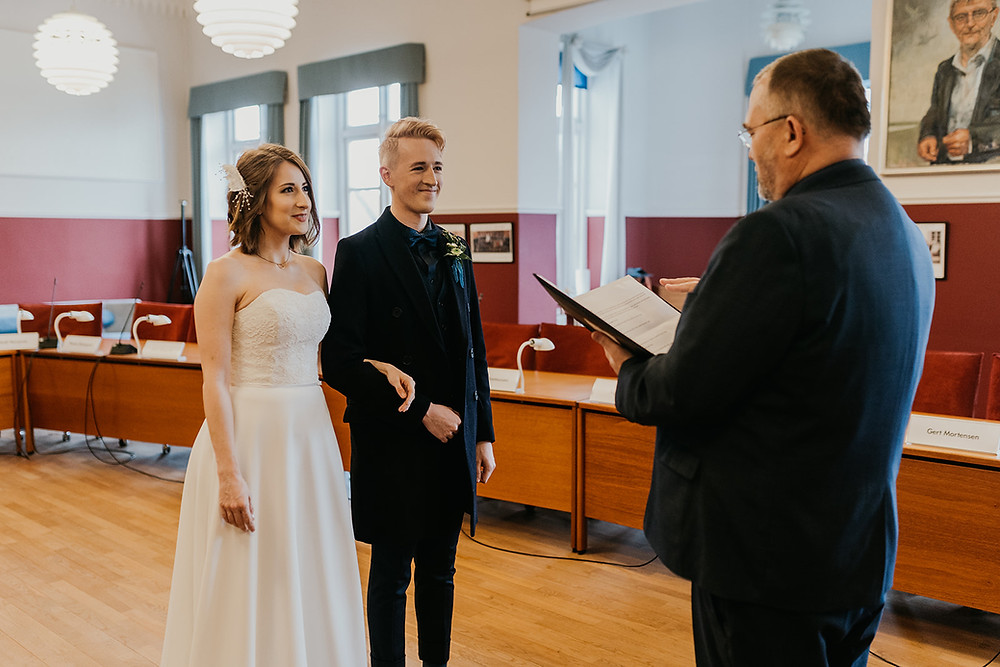 Anja & Ryan holding hands during their fast civil marriage in Denmark.