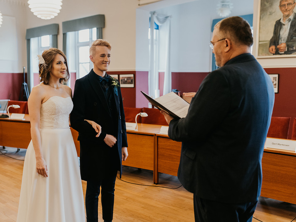 A couple getting married in Denmark with a town hall for their Danish wedding.