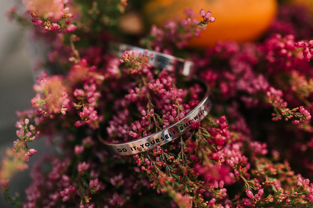 Two bracellets lies on the flowers