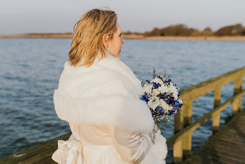 A bride looking out into the water  after booking one of our Denmark wedding packages abroad for two.