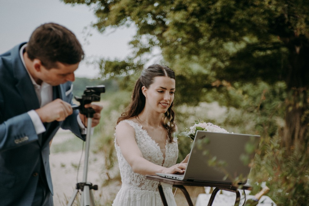 A couple streaming their elopement wedding ceremony in Denmark