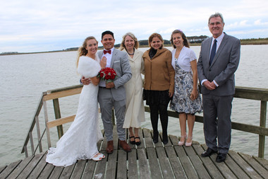 A family photo on the pier after the couple get married in Denmark.