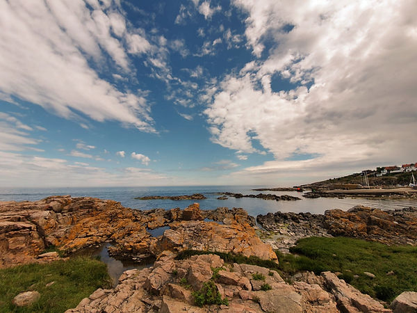 Bornholm Island's rocky, mysterious coastline, one of the many natural sights you will see during your overseas wedding here