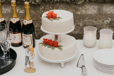 A close up of the wedding cake, one of the many charming details that go into the preparation of perfecting an intimate wedding abroad in Denmark.