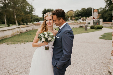 A portrait of newlyweds at the ancient historic church during their Danish wedding adventure abroad.