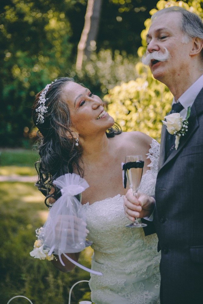 Aged bride looking at her groom with a lot of love
