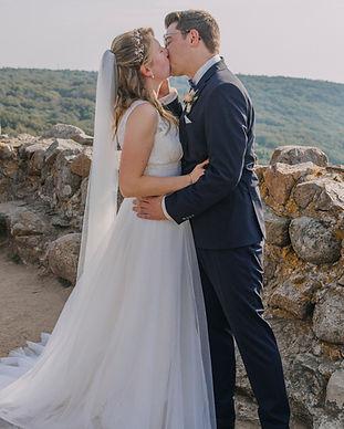Newlyweds kissing during their adventure elopement in Bornholm Island, enjoying their overseas wedding in Denmark.