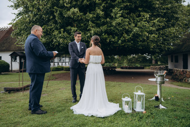 A beautiful moment captured when a couple is exchanging vows during their elopement in Denmark in an open-air museum, one of the best places to get married abroad if you are dreaming of an intimate wedding.