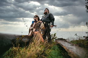 A couple in the Viking clothes looking to the horisont line.