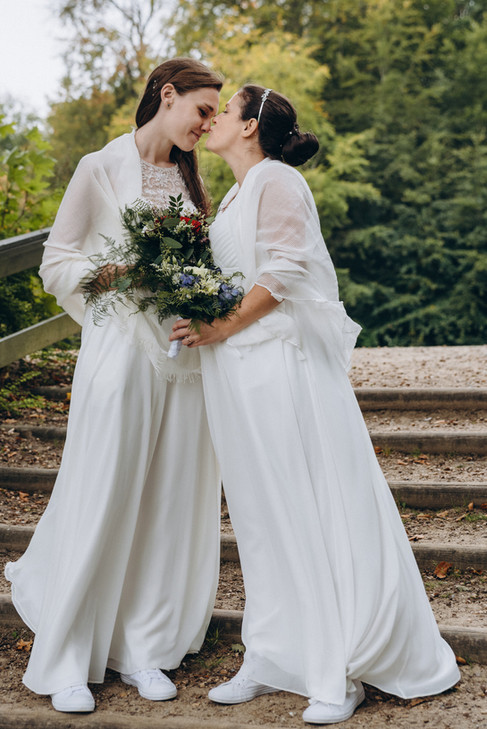 A lesbian couple kissing during their wedding in Denmark.