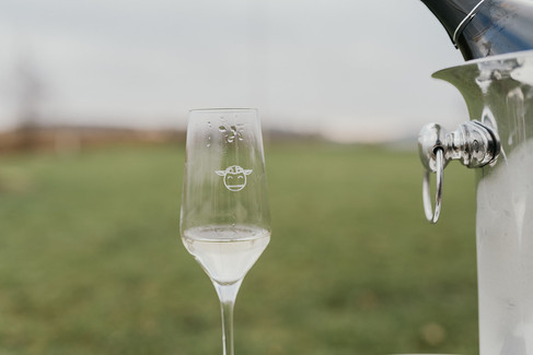 A glass of champagne to be enjoyed during a Nordic adventure wedding.